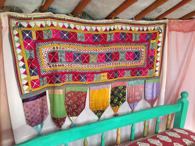 colourful wall hangings yurt