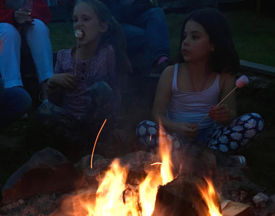 eating marshmallows by open fire
